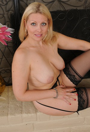 Hot mommy in stockings rides his big dick 4